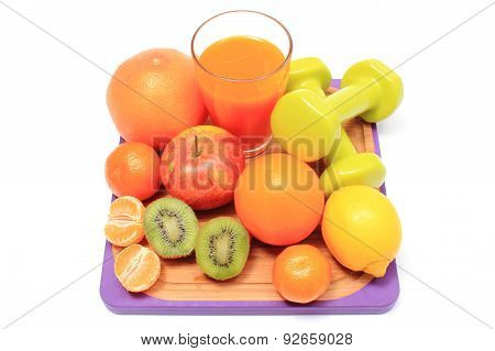 Fresh Fruits, Dumbbells And Glass Of Juice