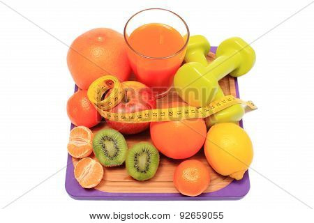 Fresh Fruits, Dumbbells, Tape Measure And Glass Of Juice