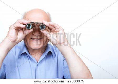 Smiling grandfather looking through binoculars