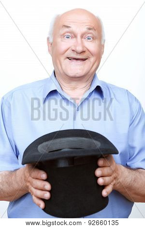 Smiling grandfather standing with hat