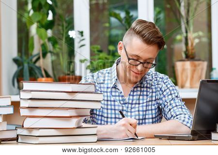 Young student working in a library