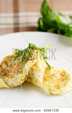 Scrambled eggs with arugula
