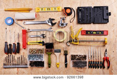 Set of tools on plywood, top view