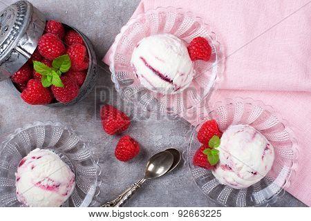 Homemade berry ice cream with fresh raspberries