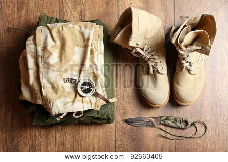 Hunting gear on wooden background