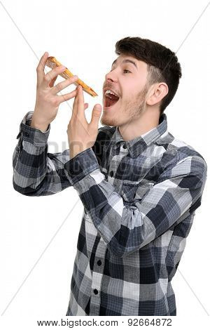 Young man eating piece of pizza isolated on white