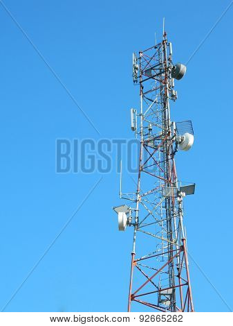 Communication Tower with  GSM Antennas LTE and amazing clear Blue Sky.