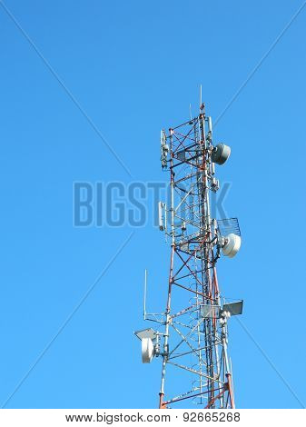 Communication Tower with Parabolic and GSM Antennas LTE and perfect Blue Sky.