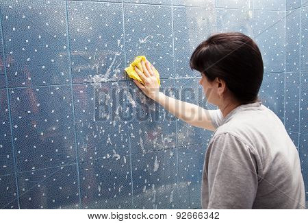 Woman Washes The Tile On The Wall With A Cloth Lather