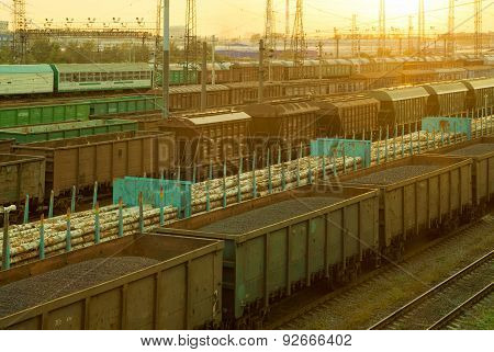 Railway Cargo Cars At Sunset