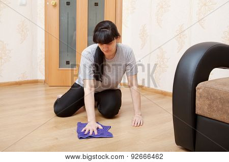 Woman Cleaning The Floor With A Cloth