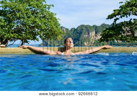 Woman Relaxing In Spa Pool At Resort