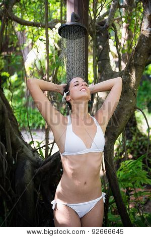 Relaxed Woman Enjoying Exotic Spa Outdoor Shower