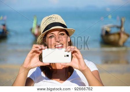 Tourist On Thailand Travel Taking Photo With Smartphone At Krabi Beach