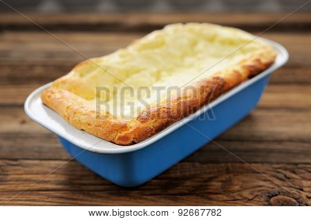 Homemade Cottage Cheese Pie In Blue Baking Pan On Wooden Background