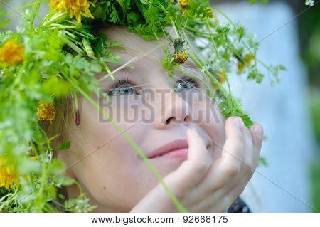 Cute Little Girl In A Wreath Of Flowers Dreaming