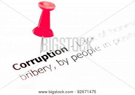 Word Corruption Pinned On White Paper With Red Pushpin