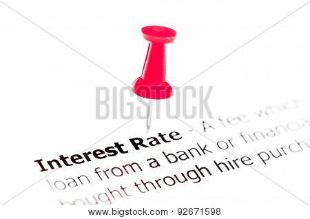 Words Interest Rate Pinned On White Paper With Red Pushpin