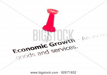 Word Economic Growth Pinned On White Paper With Red Pushpin