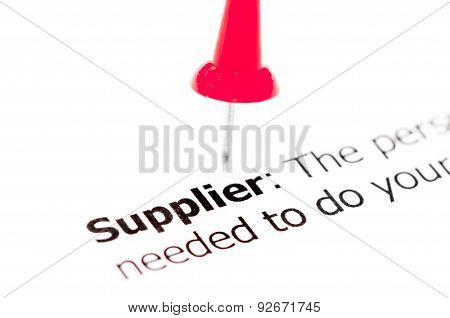 Word Supplier Pinned On White Paper With Red Pushpin