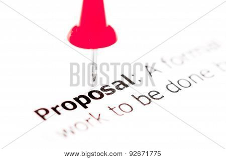 Word Proposal Pinned On White Paper With Red Pushpin