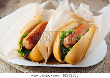 Two Hotdogs On Plate Rustic