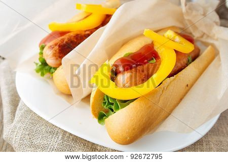 Hotdogs On White Dish  Wooden Table