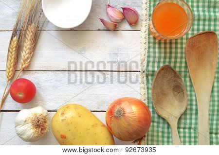 Repice ingredients on a white wooden table with tablecloth.