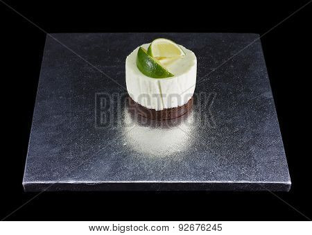 One small cake decorated with lime wedges