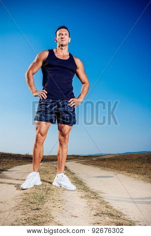 Athlete outside in nature on a dusty road