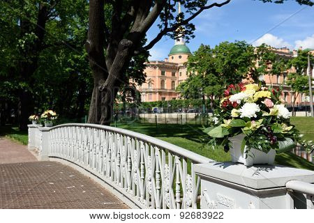 ST. PETERSBURG, RUSSIA - JUNE 4, 2015: Flowers in a vase in the Mikhailovsky Garden during the festival Emperor's Gardens of Russia. The exposition Silk Road Gardens is in focus of festival this year