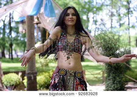 ST. PETERSBURG, RUSSIA - JUNE 4, 2015: Woman performing belly dance during the festival Emperor's Gardens of Russia. The exposition Silk Road Gardens is in focus of festival this year