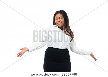 Afro american businesswoman shrugging shoulders isolated on a white background. Looking at camera