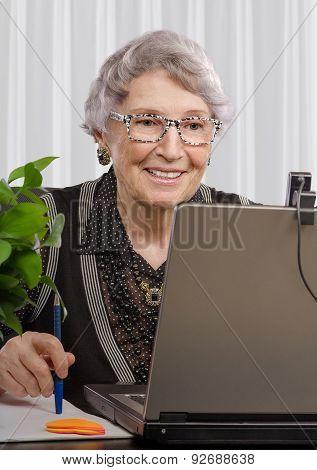 Aged Teacher Working Online