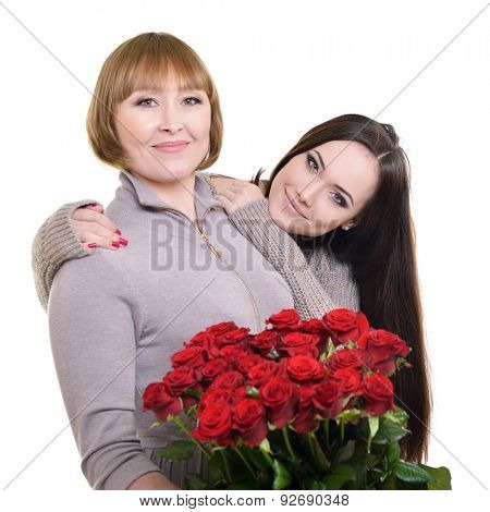 Portrait of aged mother and young daughter at Mother's day, having flowers and smiling, over white