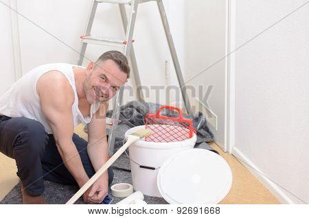 Muscular Man Doing Diy Renovations