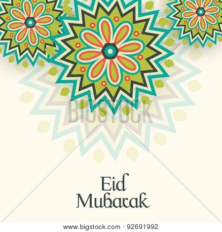 Beautiful floral design decorated greeting card for Muslim community festival, Eid celebration.