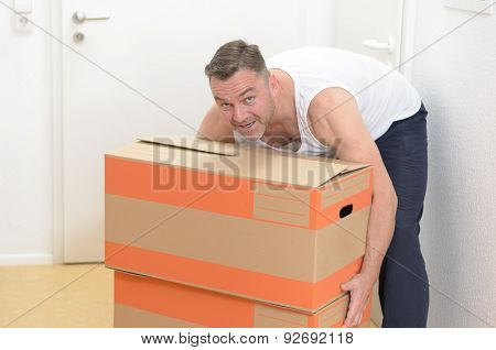 Man Moving Home Carrying Cardboard Cartons