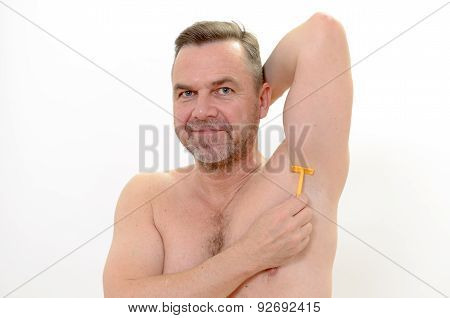 Middle-age Man Shaving His Underarm