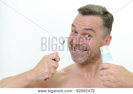 Charismatic Man Cleaning His Teeth