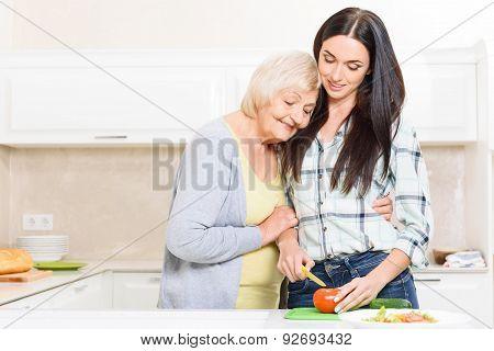 Granddaughter cutting vegetables