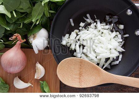 Cut Onion In A Frying Pan