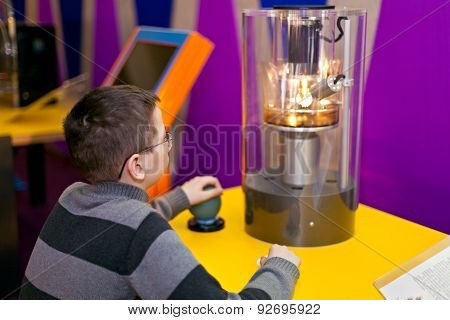 boy watching Physics Science Experiment