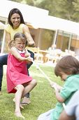 pic of tug-of-war  - Mother And Children Playing Tug Of War - JPG
