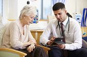 stock photo of chemotherapy  - Woman Having Chemotherapy With Doctor Using Digital Tablet - JPG