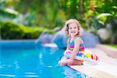 picture of floating  - Kids in swimming pool - JPG