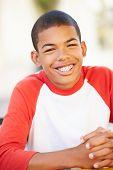 image of 13 year old  - Portrait Of Smiling Teenage Boy - JPG