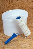 pic of lint  - set for painting bucket of white paint roller - JPG