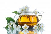 foto of jasmine  - jasmine tea in a teapot with a branch of jasmine on white background - JPG