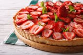 image of tarts  - homemade strawberry tart with cream cheese and mint closeup - JPG